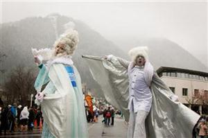 AWQWF 2013 MR3 Stilt walkers and snow featured in the annual American Express Street Parade on the opening weekend of the American Express Queenstown Winter Festival