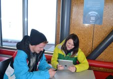 Alan Pitfield 27 and Narelle Dancey 24 use the Free Wifi at Coronet Peak