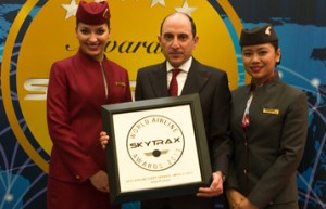 A proud Qatar Airways Chief Executive Officer Akbar Al Baker is presented with the Skytrax 2013 Best Business Class In The World award by CNN International anchor Richard Quest, flanked by cabin crew, at the Paris Air Show today. Qatar Airways won a total of three Skytrax World Airline awards this year.