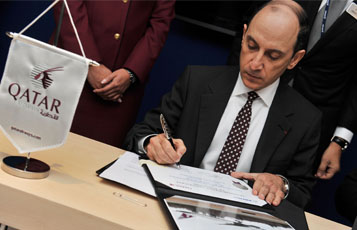 Qatar Airways CEO Akbar Al Baker is is pictured signing an order for nine Boeing 777 aircraft at a press conference on the opening day of the Paris Air Show.