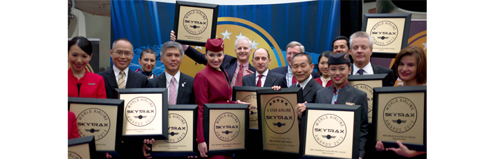 Qatar Airways CEO Akbar Al Baker is pictured with award winners from members of the oneworld alliance, which the Doha-based airline is expected to officially join by the end of the year. Qatar Airways won a total of three Skytrax World Airline awards this year.