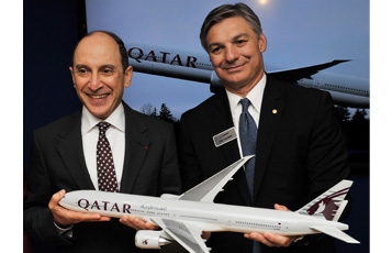 Qatar Airways Chief Executive Officer Akbar Al Baker, left, with Boeing Commercial Airplanes President and CEO Ray Conner celebrating a new order by the airline for nine new Boeing 777 aircraft.