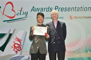 Top award winner Cathay Pacific Customer Services Officer Louis Lo receives a certificate from Cathay Pacific Chief Executive John Slosar.