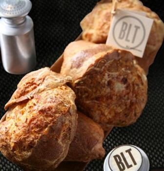 BLT Steak's signature popovers - airy golden Gruyère-laced puffs of dough served warm, start every meal