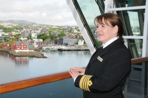 Captain Inger Olsen takes in the view of Torshavn from the Bridge of Queen Victoria
