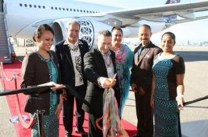 Acting CEO of Fiji Airways, Aubrey Swift (center), Fijian Ambassador to the United States, Winston Thompson (center left), Fiji's Permanent Secretary for Public Enterprises and Tourism, Elizabeth Powell (center right).
