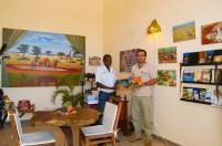 Shazaad Kasmani (right) in the new 'Wild Kenya Safaris' Safari and Tourist Information Centre in Diani, Kenya.