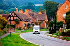 A Back-Roads Touring mini coach winds its way though the Cotswolds