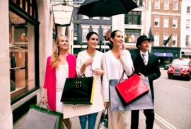 A Beadle of Bond Street helps shoppers stay away from the London rain in the London Luxury Quarter