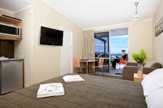 A Top Motel room at Waihi Beach features a secluded balcony with stunning sea view
