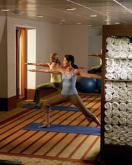Guests practice yoga in Crystal's Feng Shui fitness center