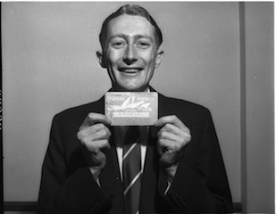 Mr R Faulder, holding his winning ticket in the fourth lottery in 1958