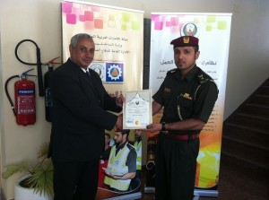 Mr. Fatah Khelif, Security Manager of Park Regis Kris Kin Hotel receives certificate from Lieutenant Colonel Yusuf Rashid Khamis