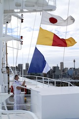 THIRD OFFICER BEN FLASH RAISES 100 FLAGS ON PACIFIC JEWEL CITY SKYLINE