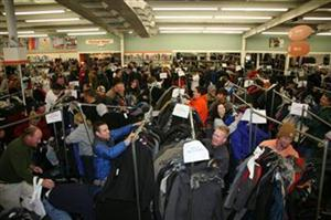 AND rush clothing racks for super-bargains on Ski Wear Sales Day.