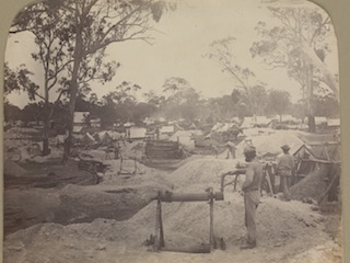 TYPICAL busy 1850's goldfields scene in Victoria. (Victoria State Library.)
