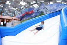 Taking a plunge down the slide at the winter playground in Changi Airport Terminal 3.