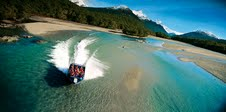 Dart River Jet Safaris guests enjoy breathtaking scenery and exciting jet boating