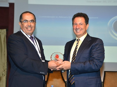 Mr Abdenbi Manar (left) General Director  Morocco s Civil Aviation Authority presents Tarek Ragheb (right) AfBAA Chairman and founder with commemorative plaque