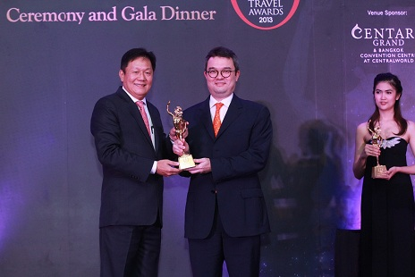Thirayuth Chirathivat (right), Chief Executive Officer of Centara Hotels & Resorts is presented with the 24th Annual TTG Travel Awards 2013 trophy from Darren Ng (left), Managing Director of TTG Asia Media during a ceremony at the World Ballroom, Centara Grand at CentralWorld.