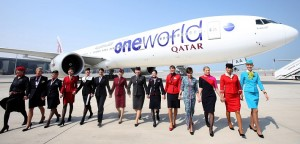 Cabin crew attendants from the member airlines of the oneworld alliance join hands following the formal inauguration of Qatar Airways into the global aviation alliance – oneworld.