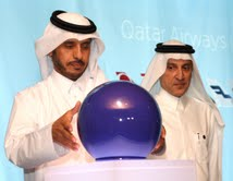 His Excellency the Prime Minister of Qatar Sheikh Abdullah Bin Nasser bin Khalifa Al-Thani officially inaugurates the State of Qatar's national carrier, Qatar Airways, as it joined the airline alliance oneworld, earlier today.  As he places the blue sphere on the lecturn, Qatar Airways Chief Executive Officer Akbar Al Baker looks on.  The inauguration ceremony took place earlier today at Hamad International Airport in Doha, Qatar.