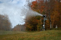 Bromley snowmaker Chris Nevitt throws the switch during a water test on October 10, 2013.