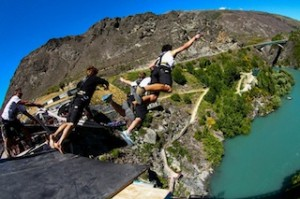 AJ Hackett Bungy crew perform a 3 person stunt-jump_media