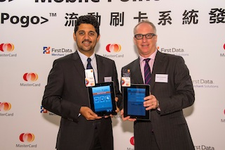 Kevin Goldmintz, Head of Hong Kong & Macau, MasterCard and Amrish Rau, General Manager, First Data Merchant Solutions jointly unveil the Pogo> Mobile Point-of-Sale (MPOS) in Hong Kong that will enhance the mobile payment experience for merchants and consumers.