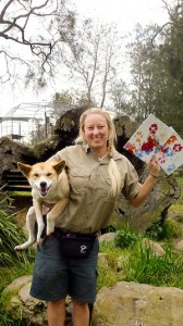 Oakvale painting dingo Kaya with trainer Lia Reeve-Parker