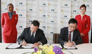 Air Seychelles Chief Executive Officer, Cramer Ball, and Cathay Pacific General Manager Revenue Management, James Tong, sign the codeshare agreement.