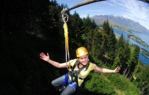 Ziptrek Ecotours guest zipping through the trees high above Queenstown