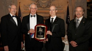 Cunard's Distinguished Service Award (L-R): Ronald L. Oswald, chairman, National Maritime Historical Society (NMHS); Richard du Moulin, overseer, NMHS; Stanley Birge, vice president, North America, Cunard Line; Richard Scarano, trustee, NMHS and owner, Scarano Boatbuilding
