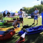 Local front line staff inflating their packrafts at the Expedition X summer launch party_media