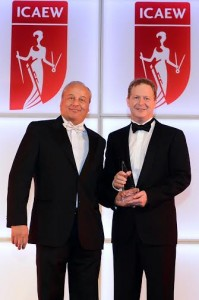James Rigney, Etihad Airways' Chief Financial Officer (right) is presented with his CFO of the Year award by Bassam Hage, Ernst & Young's Regional Managing Partner for Markets.