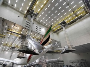 A Boeing 777 is stripped of its exterior paint in the Emirates paint hangar.