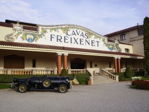 EXTERIOR of the historic Cavas Freixenet Winery in Spain, with one the company's    fleet of quirky-shaped promotional vehicles – this one the shape of a bubbly bottle. (Wikimedia)