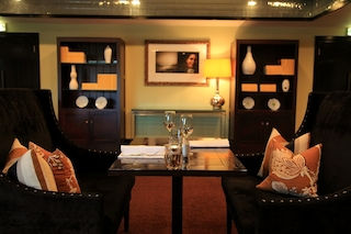Love Seat dining in The Library, Hotel St Moritz (the perfect place to enjoy our signature pinot pinot pinot)