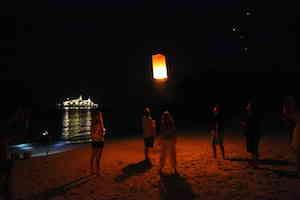 TRADITIONAL Lucky Lantern sets off heavens-ward to join others already well into the sky… (Richard    Jones)