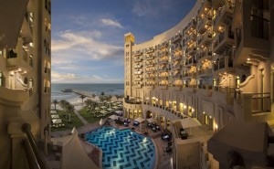 Aerial Pool and Beach Sunset -The Ajman Palace