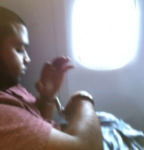 Australian Abdul Zain Ali in handcuffs after he was subdued on a flight from China to Vancouver