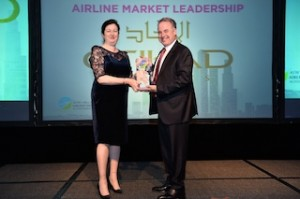 Etihad Airways' President and Chief Executive Officer James Hogan accepts the Airline Market Leadership Award from ATW Editor-in-Chief Karen Walker at a gala ceremony in Singapore.