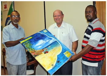 jude and egbert presenting minister with painting