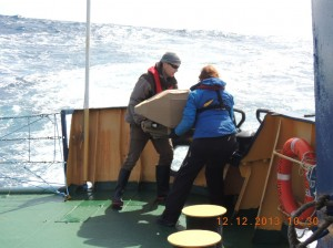 Eric van Sebille and a colleague deploying one of a pair of drifting buoys in the Southern Ocean