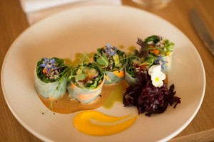 Fresh spring rolls with tamarind and spicy almond sauces and ginger and beet sauerkraut