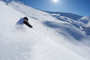 Skier enjoys a run on mid-Towers at Mt Hutt