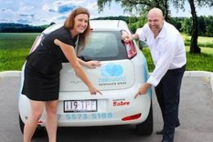 Skye Collie and James Quinlan from Sabre Pacific with the powered by Sabre logo.
