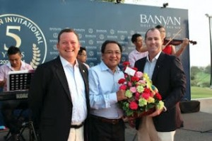 Banyan Golf Club general manager Stacey Walton and director of operations Stuart Daley make a presentation to TAT governor Khun Tawatchai Arunyik during the club's 5th anniversary celebrations.