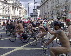 International event - naked cyclists pedal through Piccadilly Circus, London