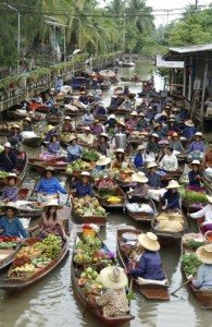 The floating market at Samut Songkhram south of Bangkok is one of many popular tourist attractions near the city.